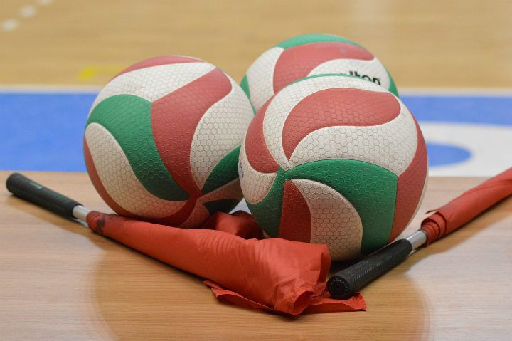 volleyballs and flags on the court
